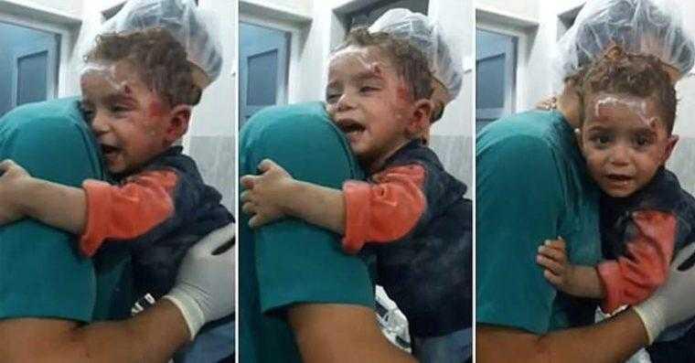Garoto sírio ferido encontra conforto nos braços do enfermeiro